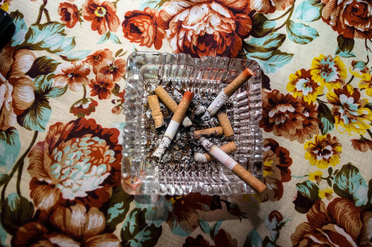 Cigarettes with lipstick of sex workers in an ashtray.