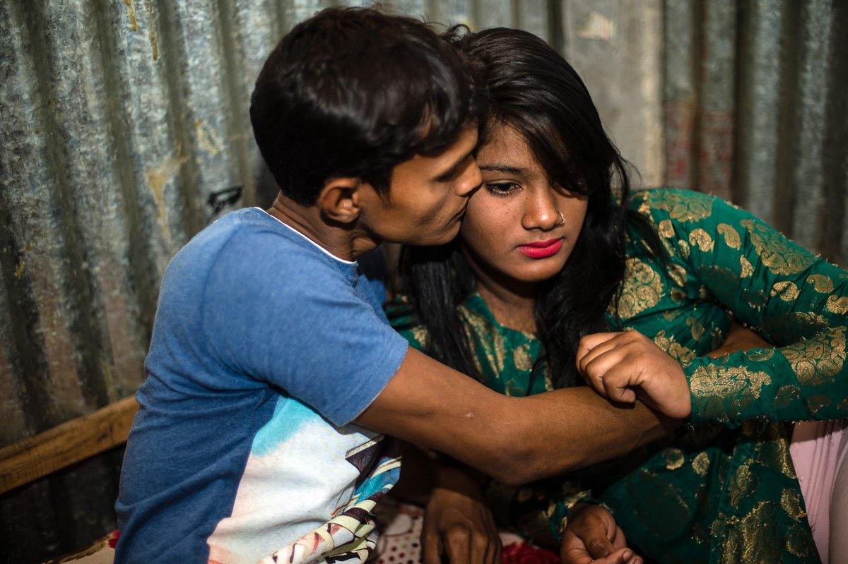 Asma, 14 years, with a customer in her room. She was born in the Kandapara brothel in Tangail. She started working as a sex worker when she was 14 years old. Before she danced in front of customers.