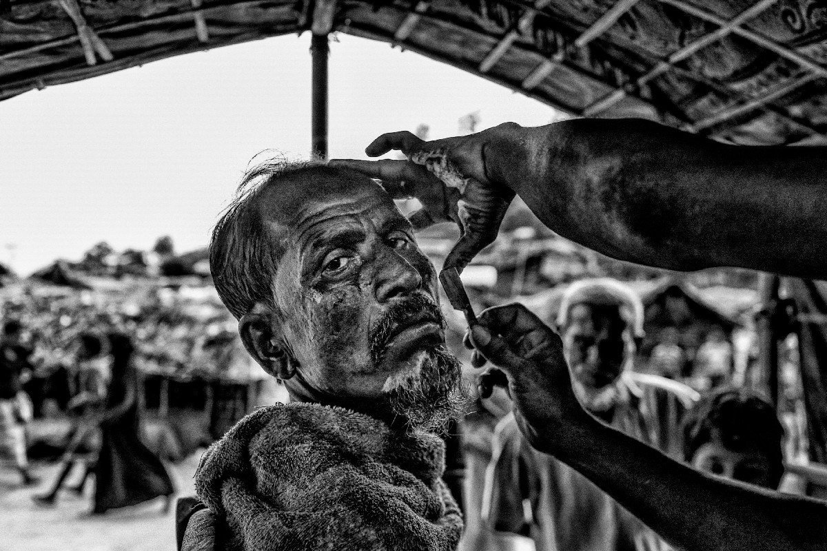 A Rohingya refugee has started a barbershop in a refugee camp to sustain in the long run.