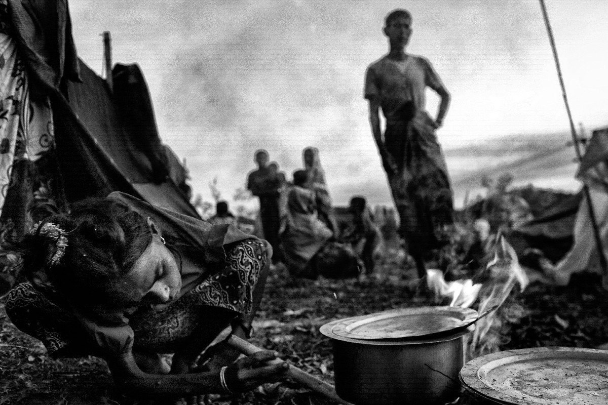 Newly arrived Rohingya refugees find their temporary shelter on a mountain in Bangladesh.