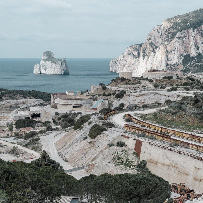 At the end of the 17th century, Masua's mining site was already famous – old excavations, tunnels and stoves in the limestone rock are present. In the background, the Pan di Zucchero, one of the main naturalistic attractions. In Masua's beach, there are cadmium, lead, zinc and arsenic.