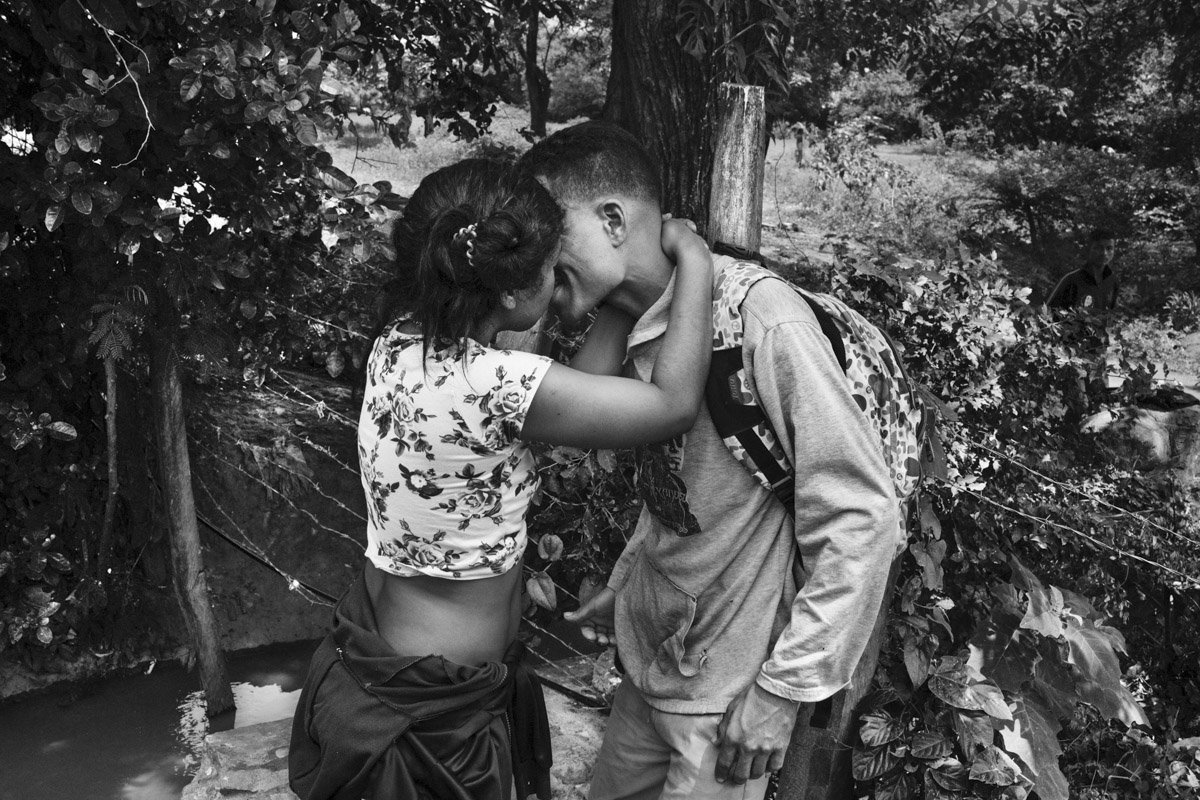 A couple of Venezuelan immigrants kiss. They are happy that they have arrived in Colombia in Villa del Rosario border town.