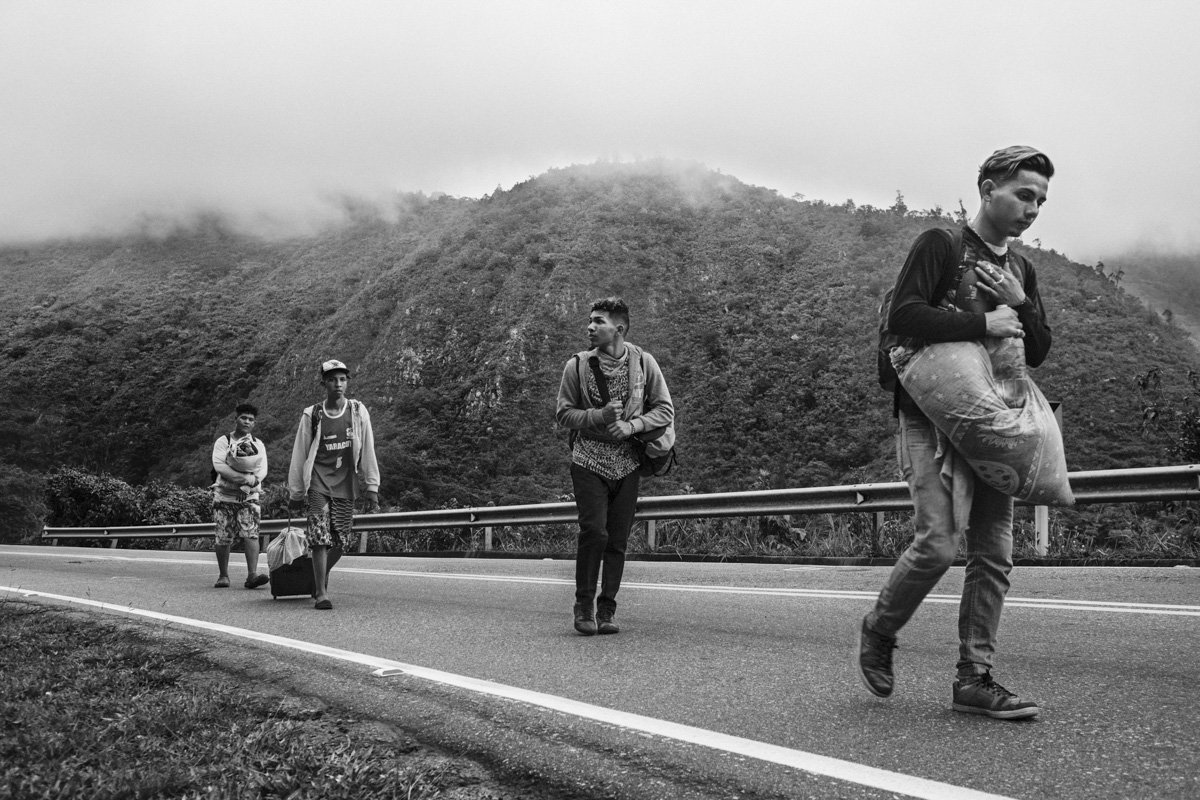 "Migrants known as ""los caminantes"" (the walkers) hike from the border to Bogota before continuing to Ecuador and beyond, on the Andean mountains of Colombia."