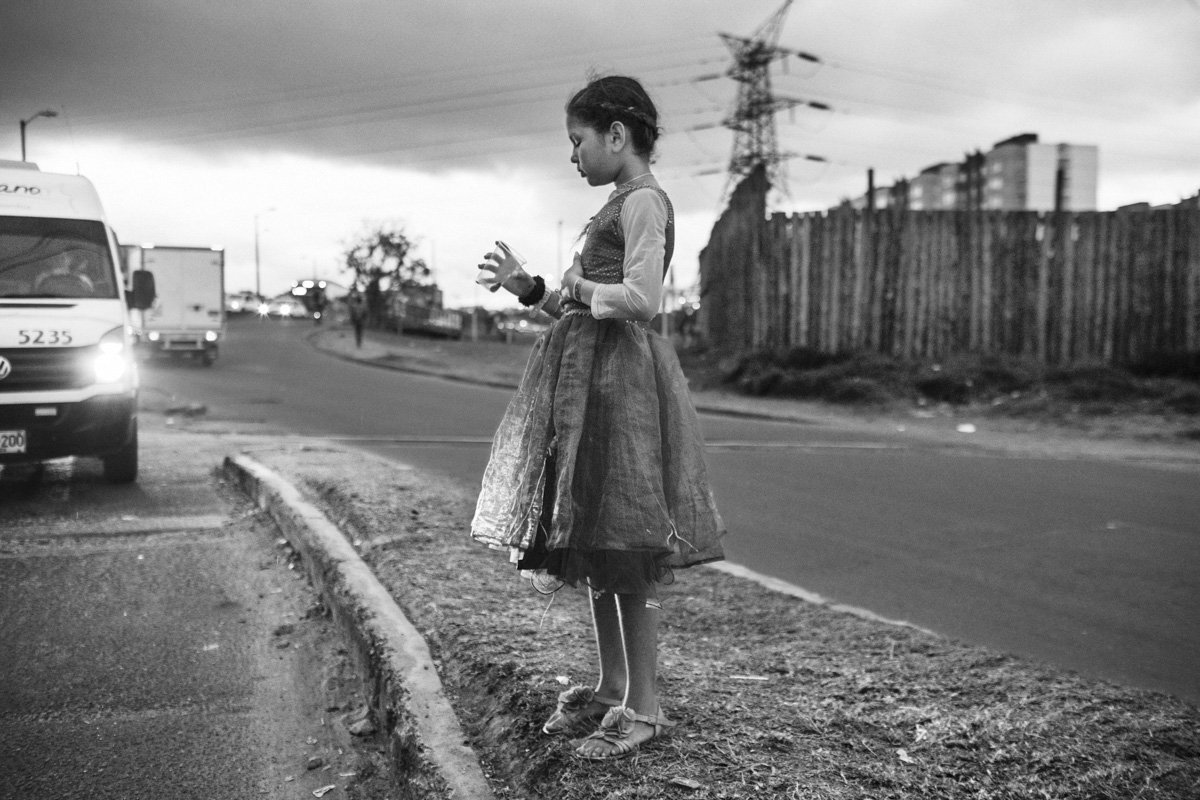 A young girl begs for money on the street in the Colombian capital, Bogota. By June 2019, the Colombian Institute of Family Welfare (ICBF) took care of nearly 80,000 Venezuelan children, adolescents and families countrywide.