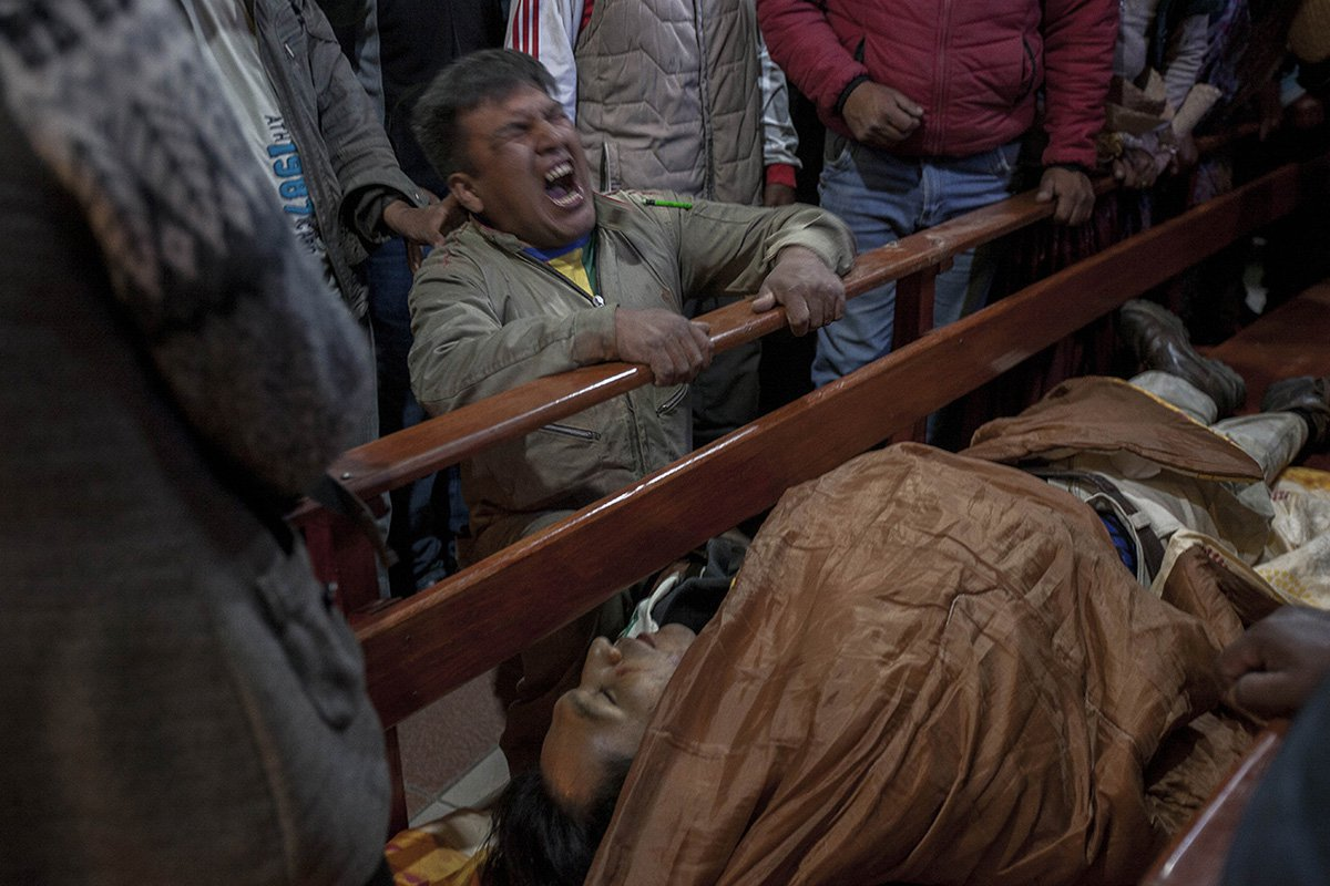 The man cries as he identifies the body of his brother – Pedro Quisbert Mamani, 37 years old. He got killed during clashes between supporters of Bolivian ex-President Evo Morales and security forces.  
