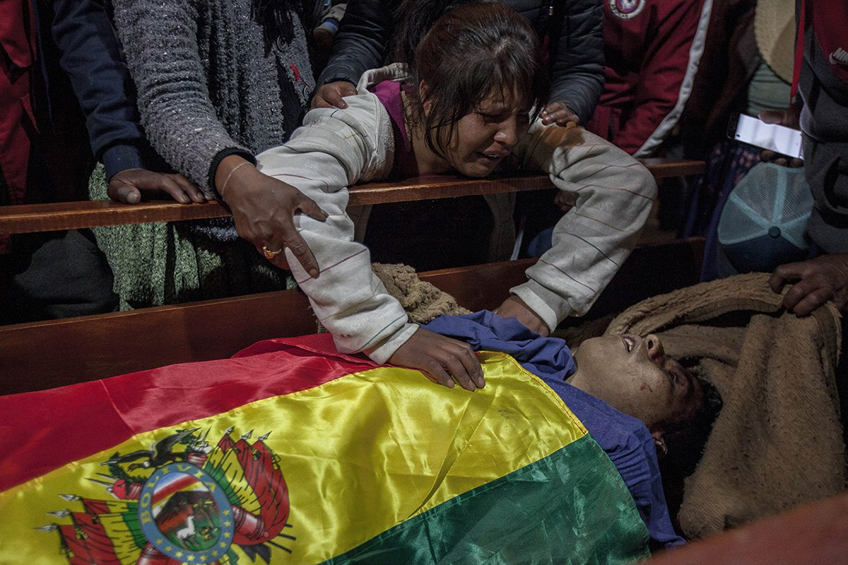 The sister of Antonio Ronald Quispe, 23 years old, mourns over his body. He was killed during clashes between supporters of Bolivian ex-President Evo Morales and security forces.
