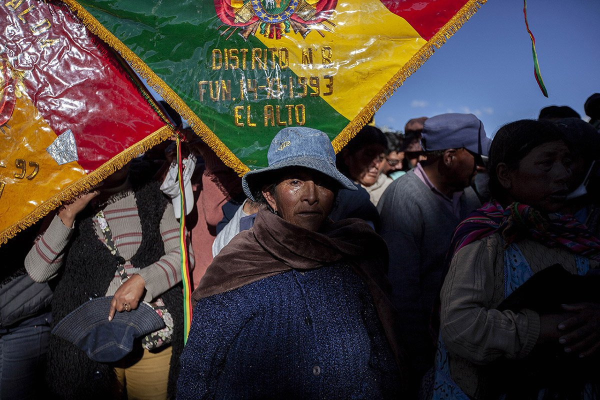 A woman attends a large funeral of seven men killed during clashes between supporters of former Bolivian President Evo Morales with security forces during a demonstration. 